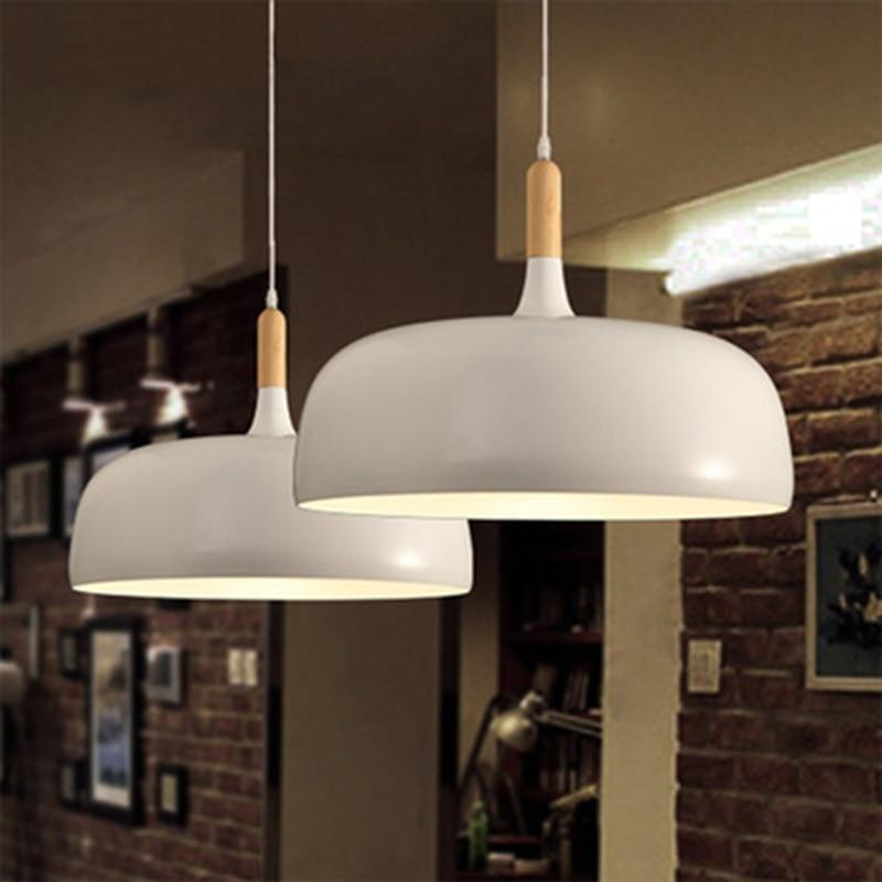 two-white-pendant-light-in-a-bar-Zavato-Home