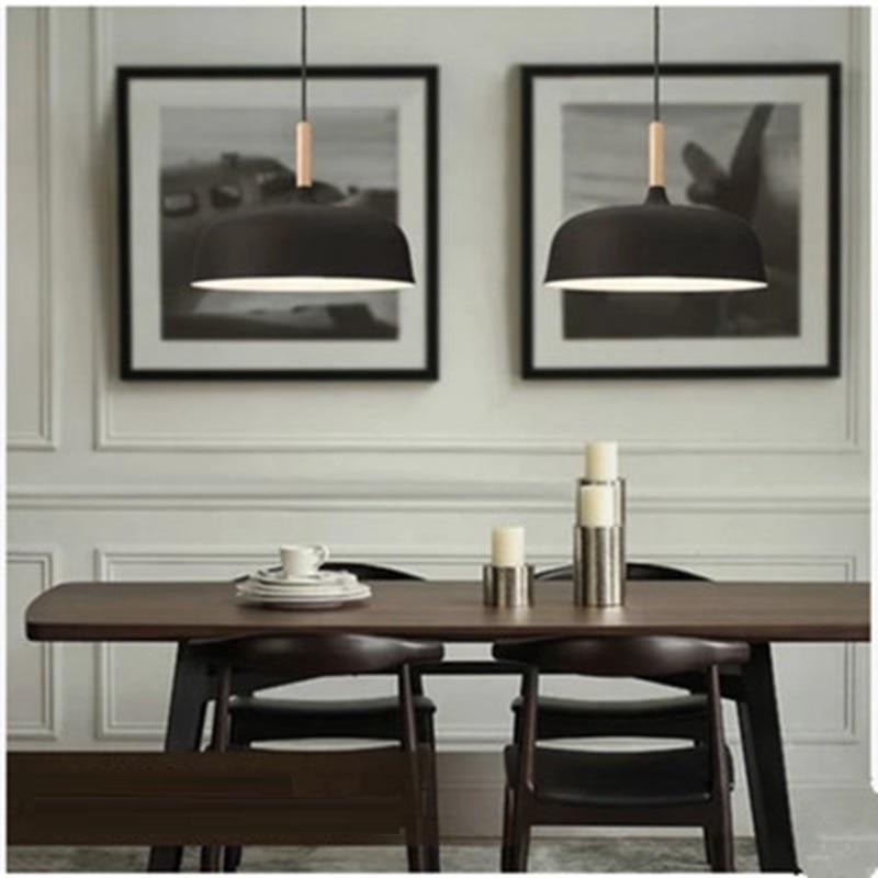 two-black-pendant-lighting-over-a-table-Zavato-Home
