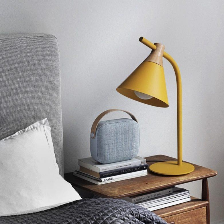 yellow-desk-lamp-on-a-bedside-table-Zavato-Home
