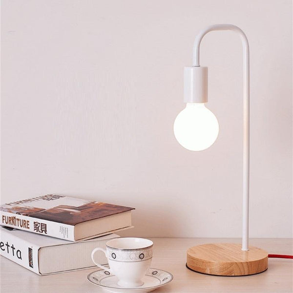 white-shadeless-table-lamp-displayed-with-books-Zavato-Home