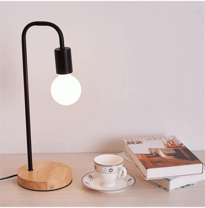 black-table-lamp-displayed-with-books-Zavato-Home