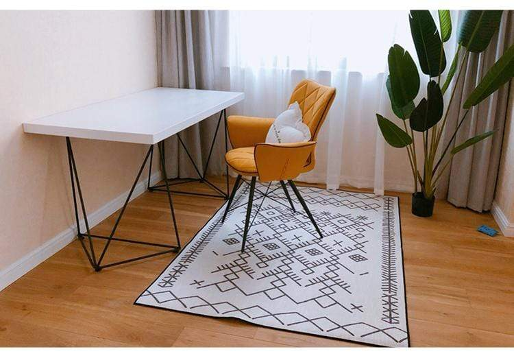 modern-rug-under-a-chair-and-table-Zavato-Home