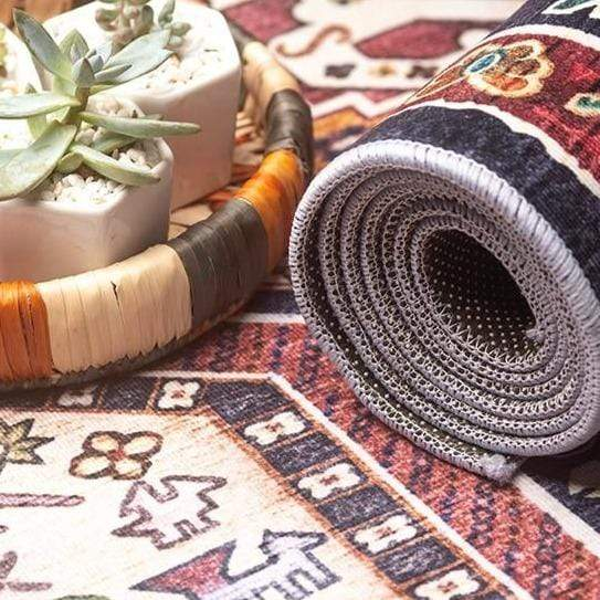 close-up-of-rolled-vintage-rug-Zavato-Home