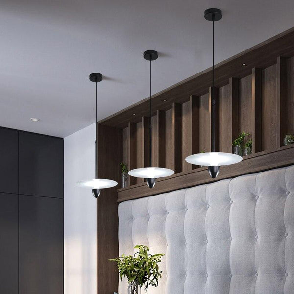 three-white-pendant-lamp-hanging-from-a-ceiling-Zavato-Home