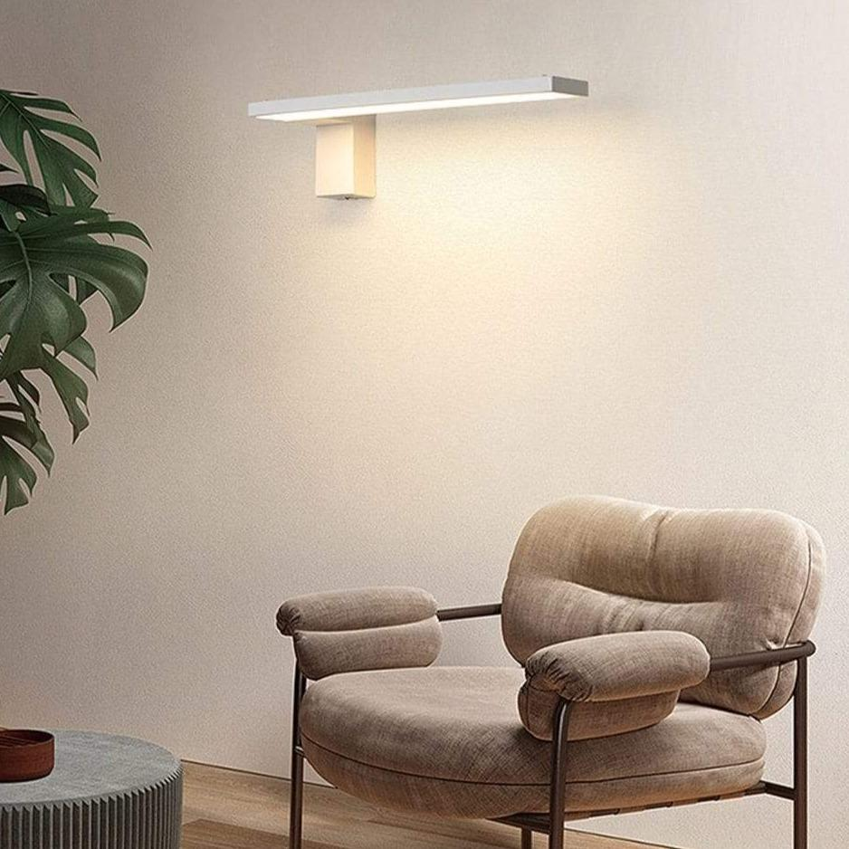 LED-indoor-wall-lamp-near-a-chair-Zavato-Home