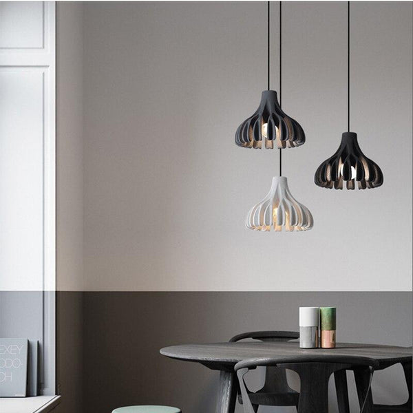three-statement-pendant-lighting-over-a-table-Zavato-Home