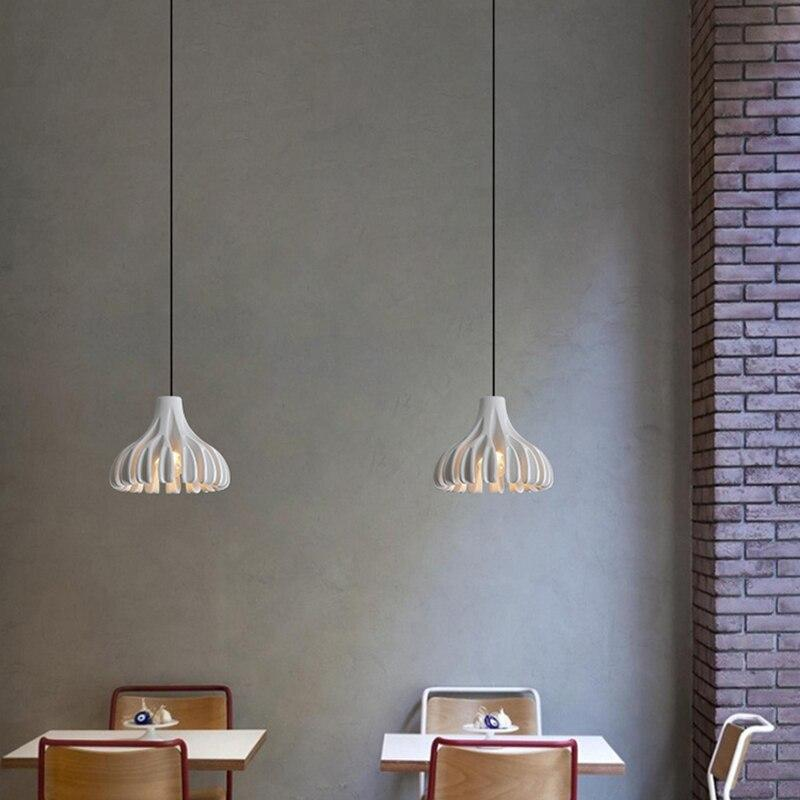 two-white-pendant-lamps-over-two-tables-Zavato-Home
