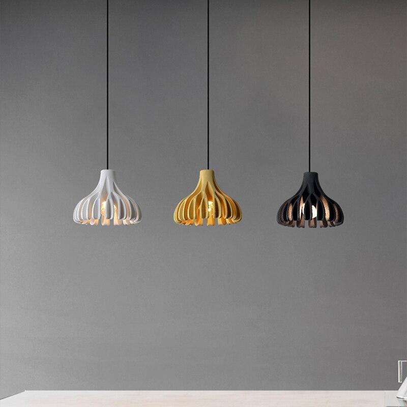 white-yellow-and-black-pendant-lamps-hanging-Zavato-Home