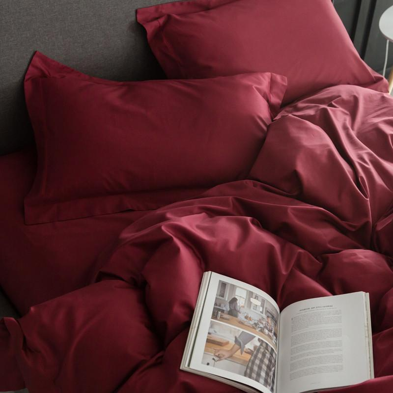 close-up-of-red-bedding-set-with-magazine-Zavato-Home