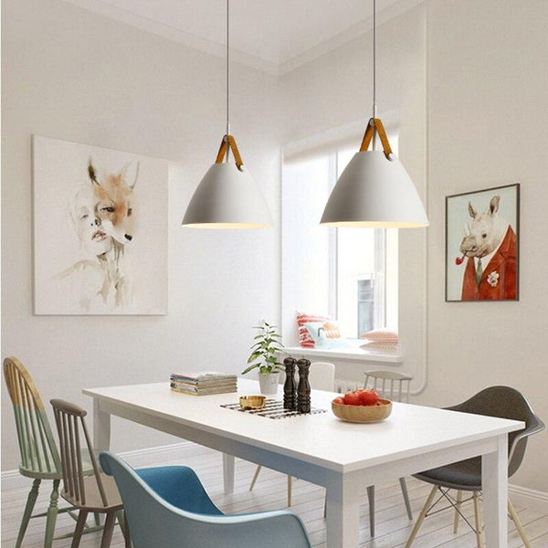 two-white-pendant-lamps-over-a-table-Zavato-Home