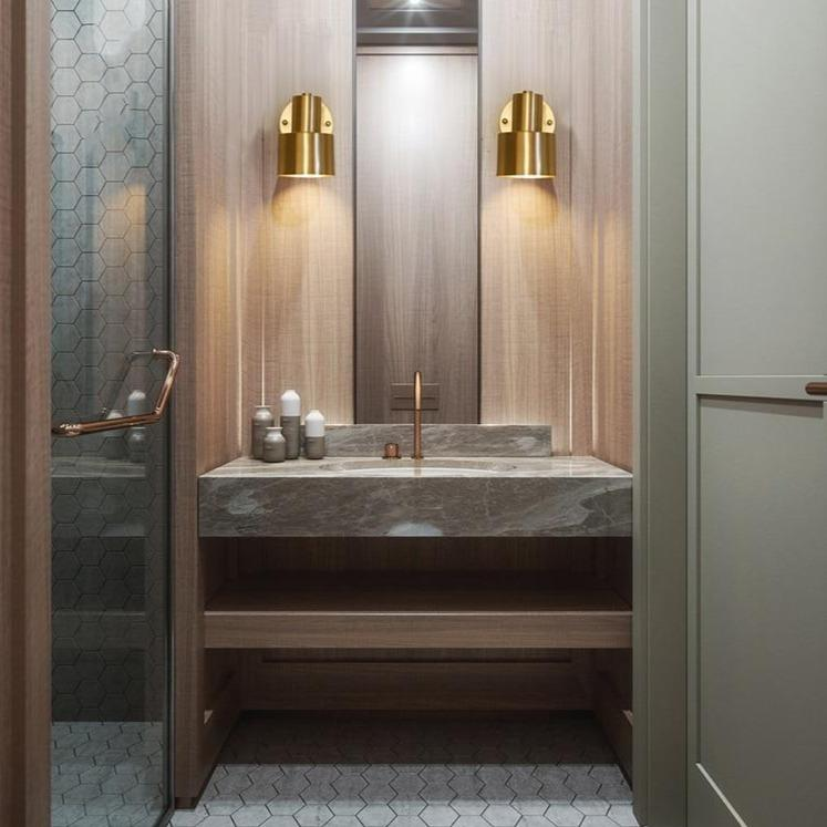 two-golden-wall-sconce-near-the-sink-Zavato-Home