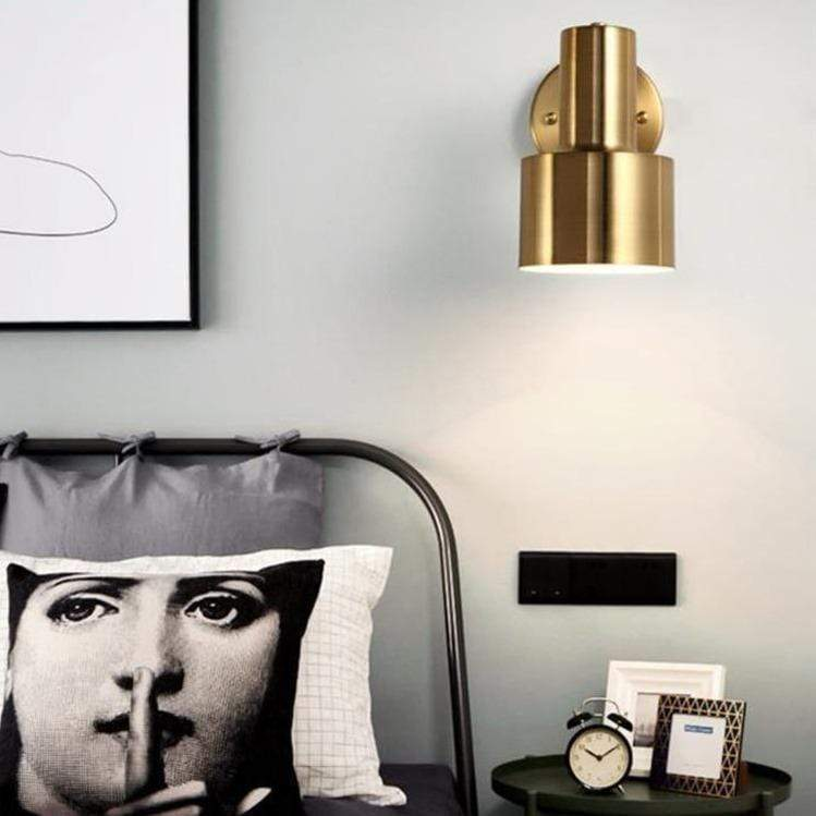 golden-wall-sconce-displayed-Zavato-Home