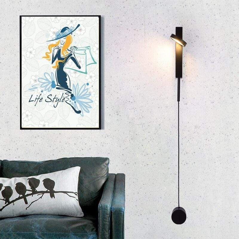 black-dimmable-sconce-on-a-bedroom-wall-Zavato-Home