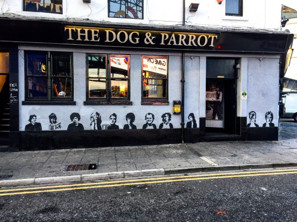exterior of pub painted with stencils of famous faces