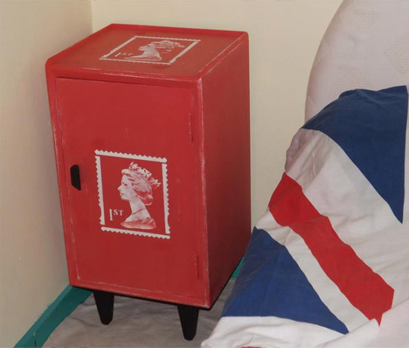 queens head stamp stencil on red bedside table