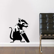 Banksy Sawing Rat