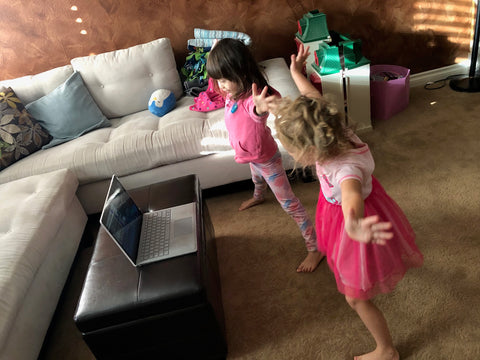 Two kids dancing to a live online activity