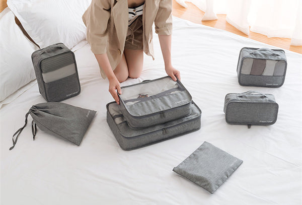 Packing Cube Luggage Travel Organizer Gray Woman Arranging Luggage