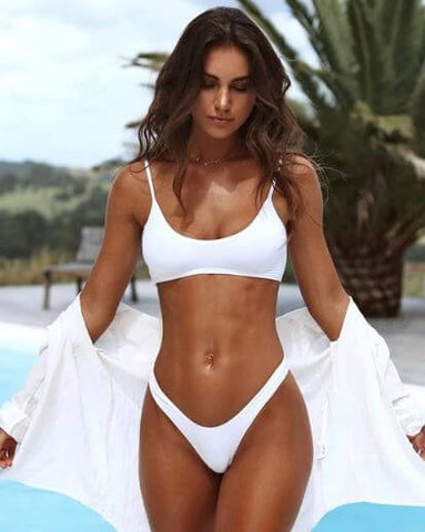 tan brunette wearing a simple white two piece bikini | maika swimwear