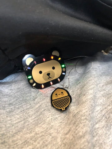 colourful light on cute bear badge and acorn-shaped component
