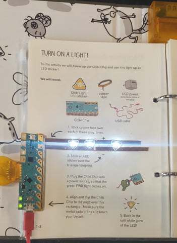 "working (lights on) simple circuit with ""Love to Code"" book"