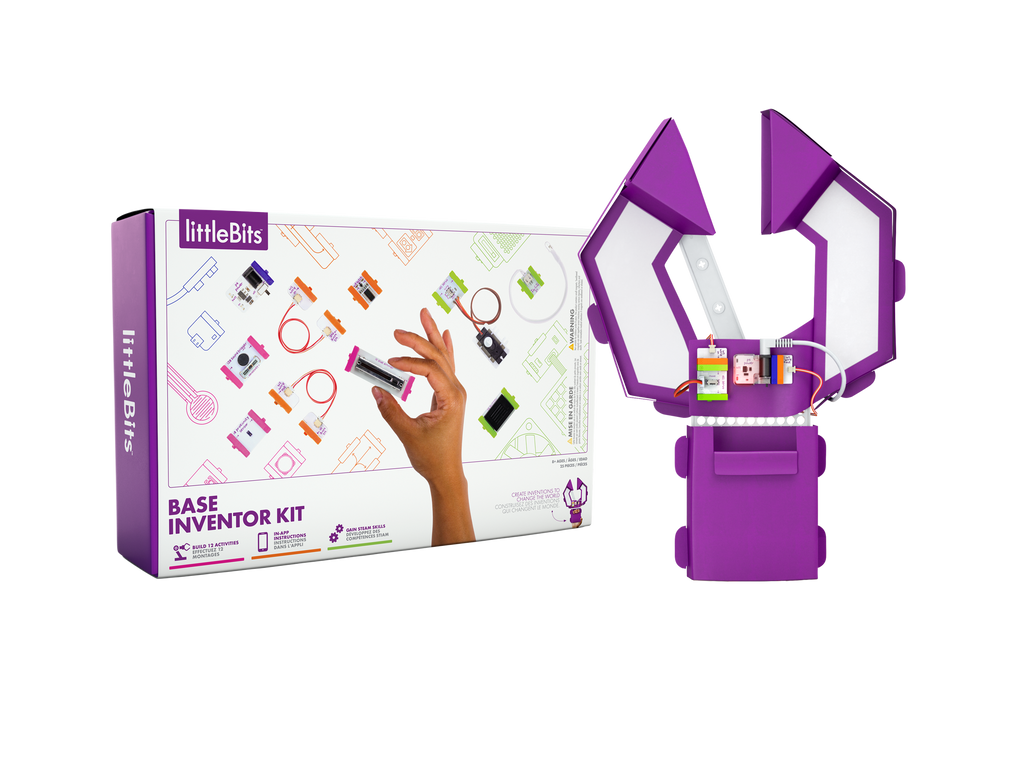 White rectangular box with colourful magnetic components designs and a hand holding a slide dimmer. Cardboard claw made from magnet components