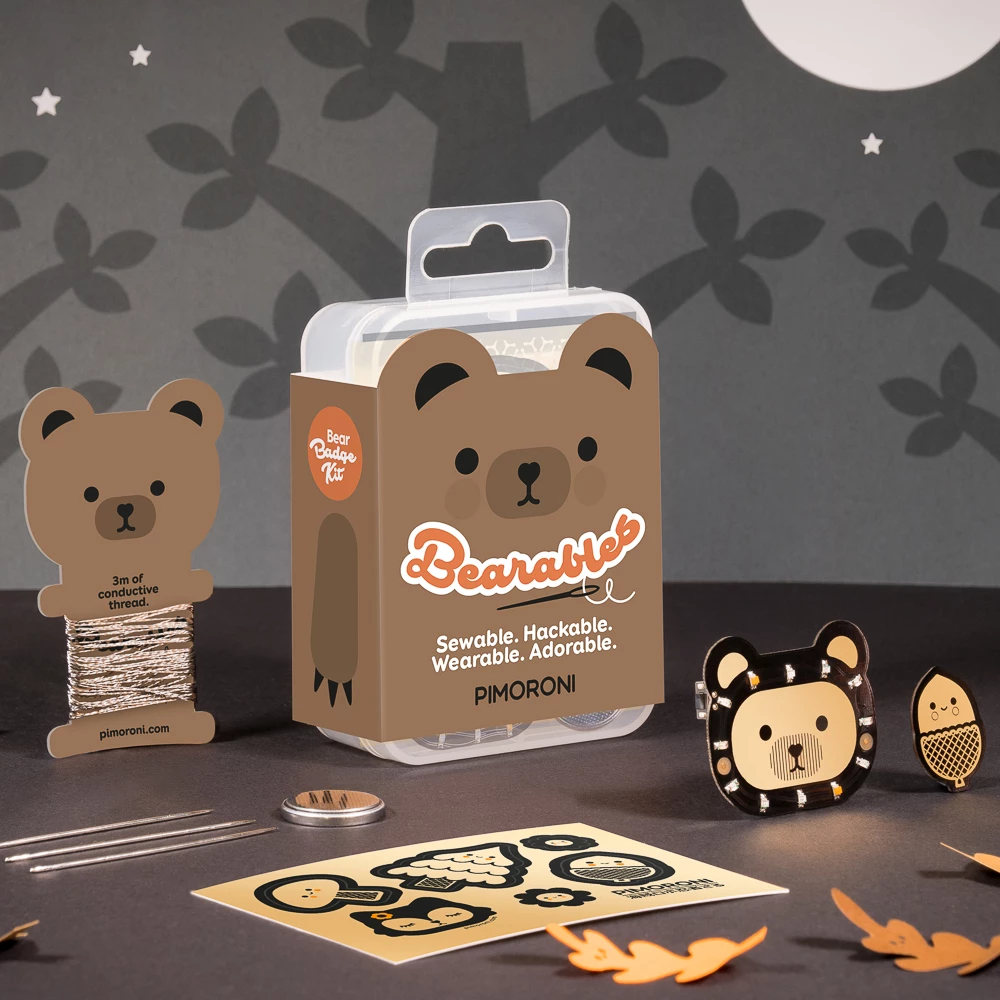 Colourful and cute brown bear packaging on a clear rectangular box with cute paper cutouts for kids