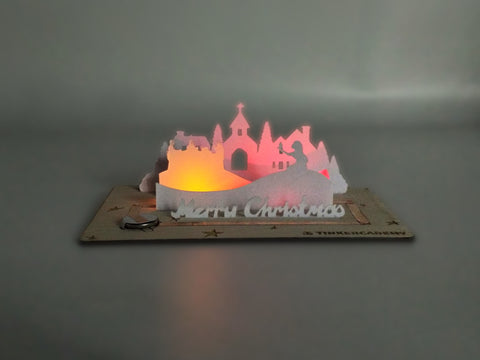 Tinkercademy's Evergreeting Diorama Kit Christmas Greeting Card lighted; Paper craft with Chibitronic LEDs and copper tape.
