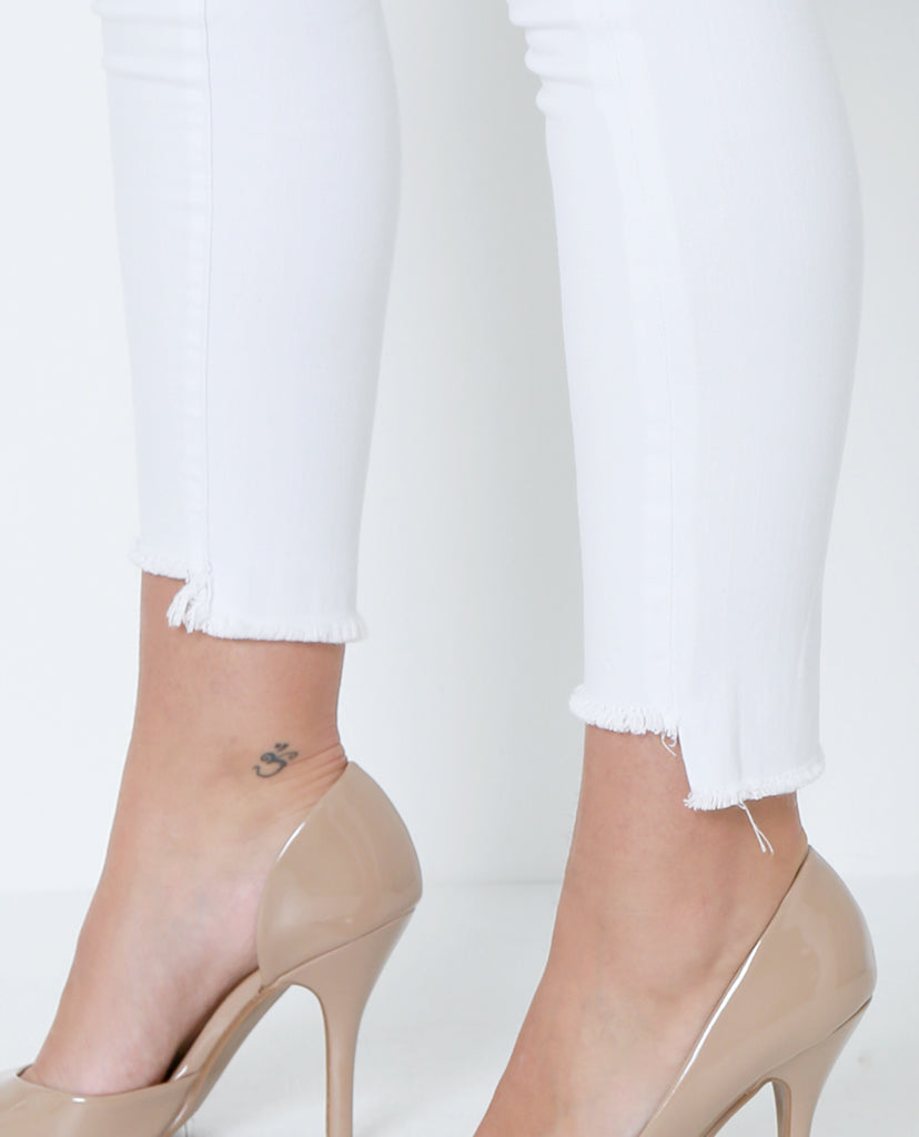 White Out High-Low Skinny Denim Jeans - White