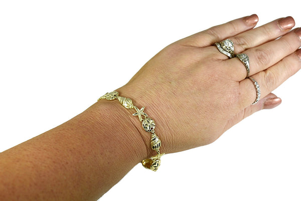 14k Coastal Themed Bracelet Shells Starfish Sand Dollars 9g Gold