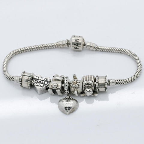 Authentic Pandora Sterling Silver Bracelet with 7 Charms