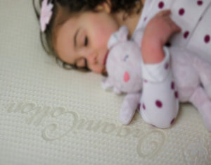 Little Girl Sleeping on Organic Cotton Cover