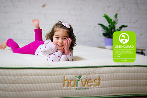 Little Girl On Original Greenguard gold mattress