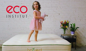 Girl Standing On Mattress eco-INSTITUT Certified Latex Logo
