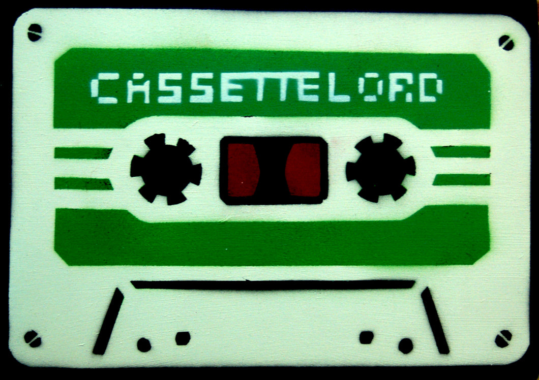 Contemporary spray paint stencil street art cassette