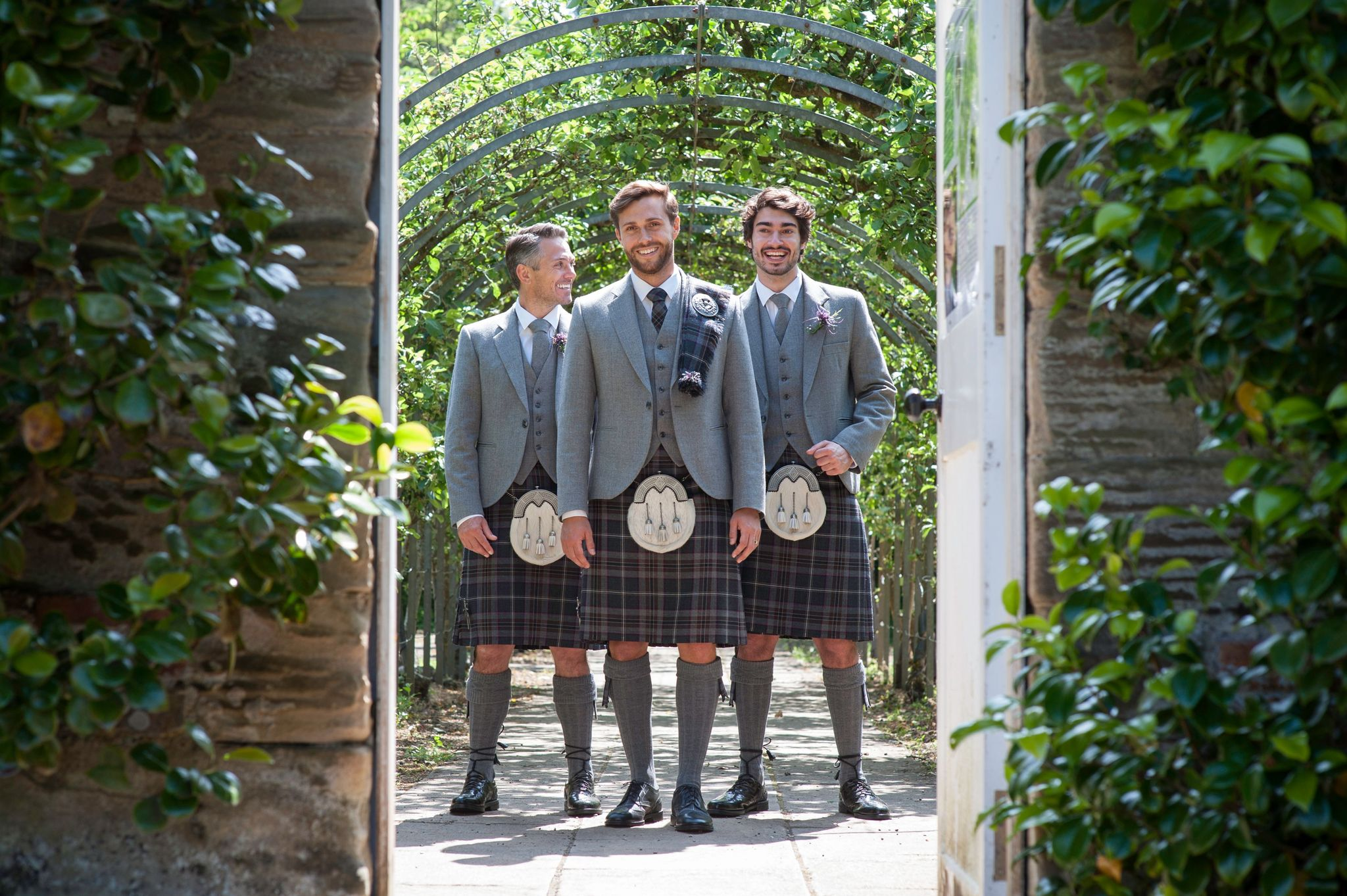 How does the word tartan differ to the word plaid