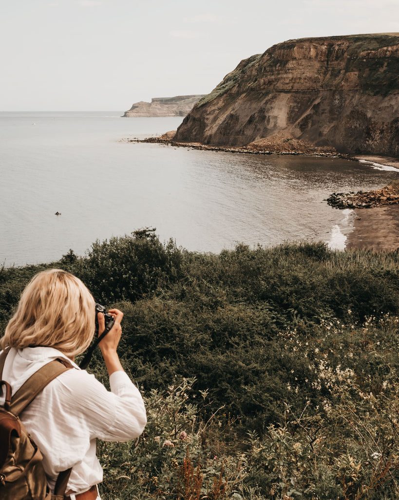 Lucy taking a photo of Port Mulgrave beach