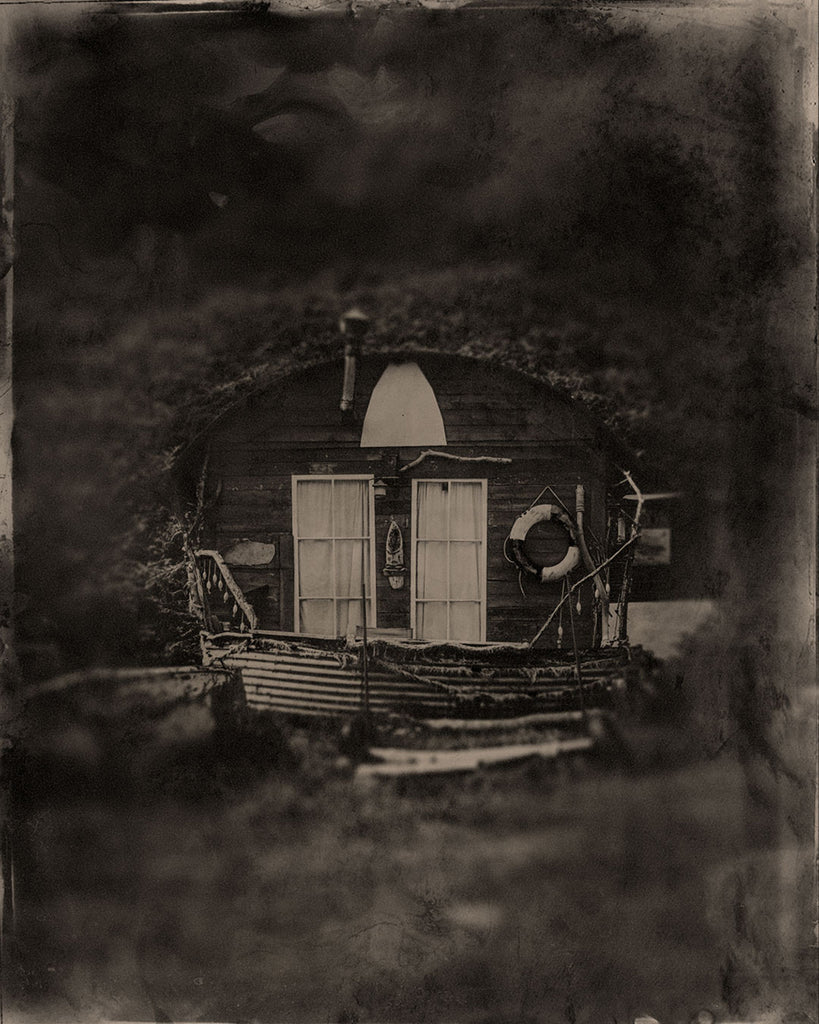 tin type of a fishermans hut at port mulgrave