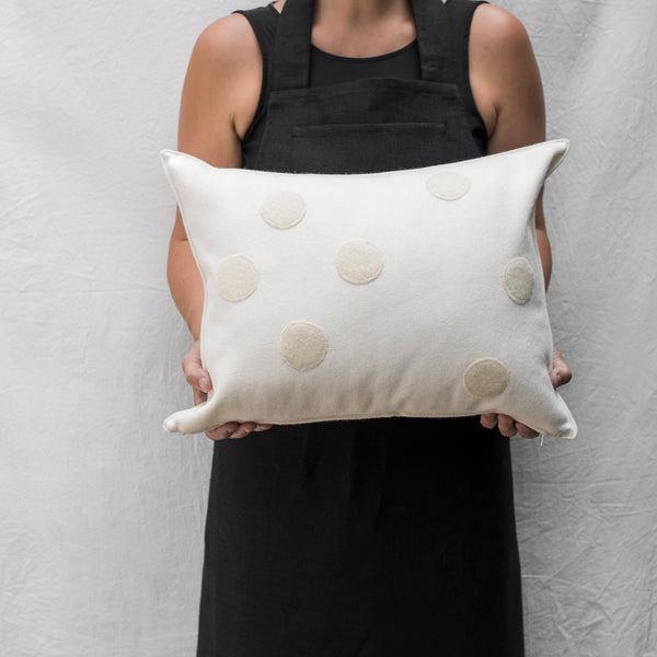 applique wool pillows. cream and white dots