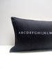 black alphabet pillow