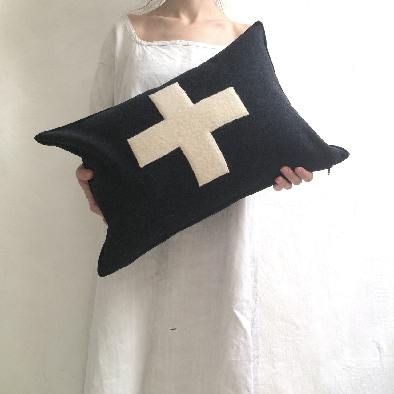 applique wool pillows. cream and black cross