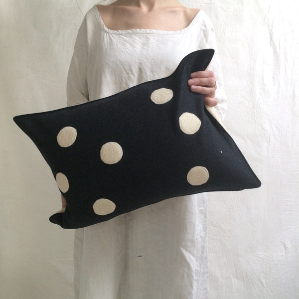applique wool pillows. cream and black dots