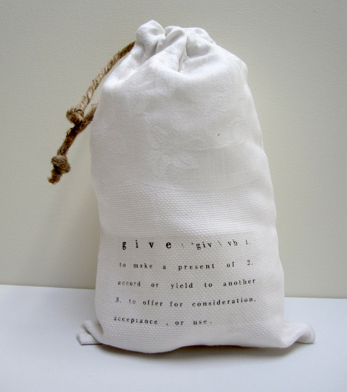 vintage textile bags with text