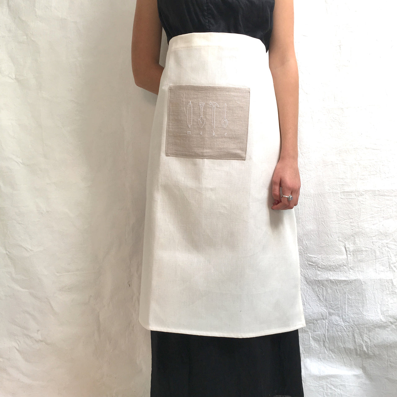 half apron with 'make' pocket