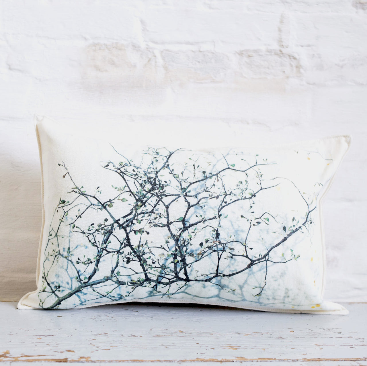 branch and text pillow