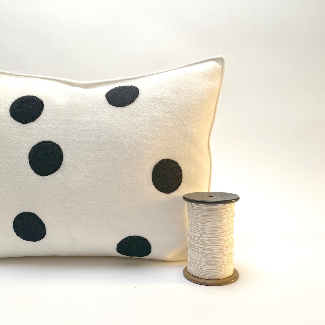 applique wool pillows. white and black dots