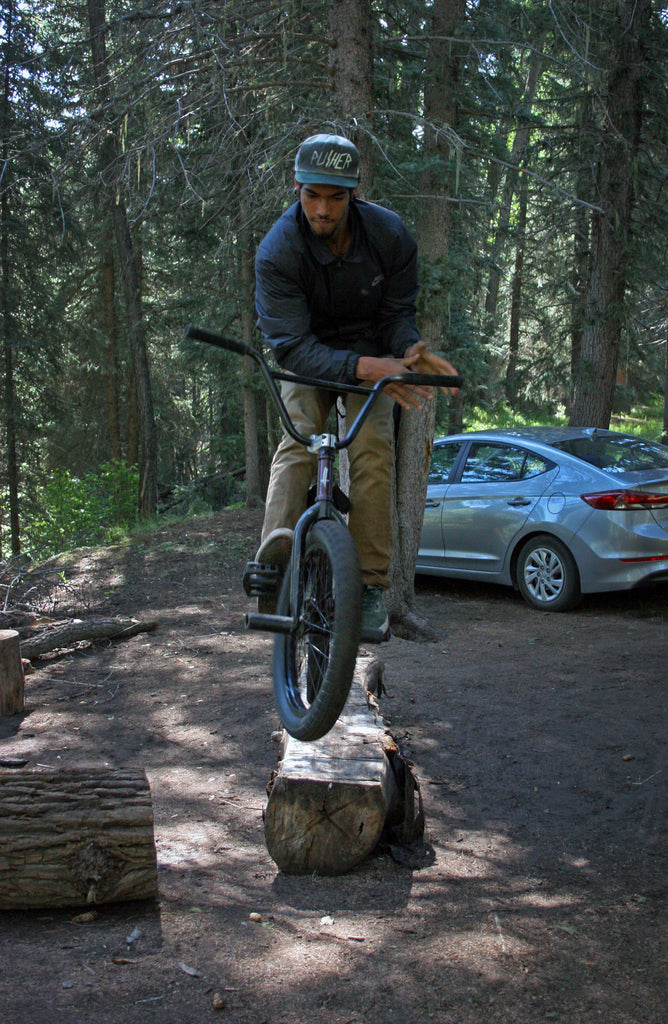 Devin Burks Log Bar Spin at Campsite. Photo Credit: Preston Levi