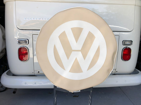 Spare wheel cover in light beige with white logo.