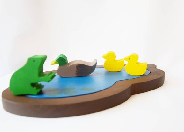 Wooden pond with 3 ducks and frog