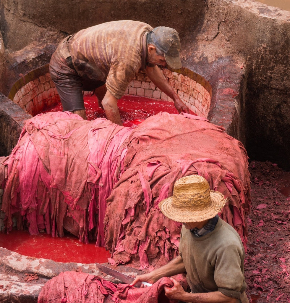 Textile workers dyeing fabric